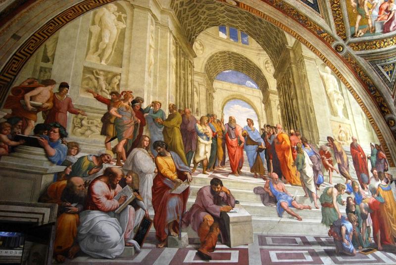 中央で上を指しているのがプラトン,下を指しているのがアリストテレス